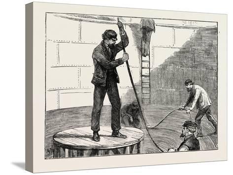 Manufacturing an Electric Telegraph Cable: Coiling Down the Cable in the Tank, 1873--Stretched Canvas Print