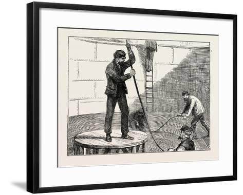 Manufacturing an Electric Telegraph Cable: Coiling Down the Cable in the Tank, 1873--Framed Art Print