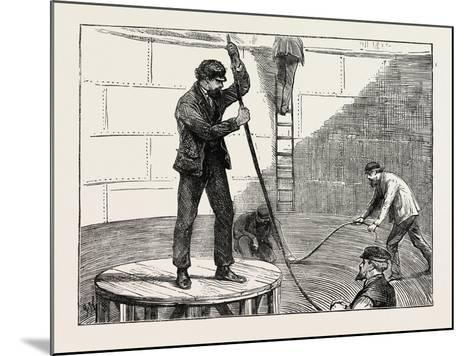 Manufacturing an Electric Telegraph Cable: Coiling Down the Cable in the Tank, 1873--Mounted Giclee Print