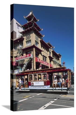 Tram in Front of a Building, Grant Avenue, Chinatown, San Francisco, California, Usa--Stretched Canvas Print