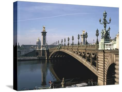 Arch Bridge across a River, Pont Alexandre Iii, Seine River, Paris, France--Stretched Canvas Print