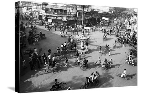 Chaos, Cycles and Rickshaws at City Road Intersection, Varanasi, Uttar Pradesh, India, 1982--Stretched Canvas Print
