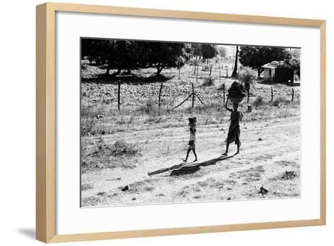 Mother and Child Carrying Cow Dung Cake, Borivali National Park, Mumbai, India, 1973--Framed Art Print