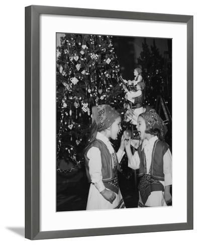 A Group of Children Decorating the Croatia Tree During the Annual Christmas around the World Festiv--Framed Art Print