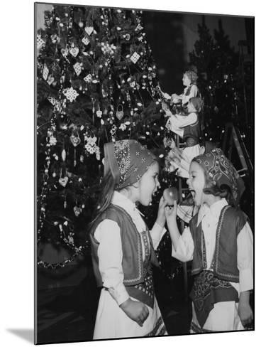 A Group of Children Decorating the Croatia Tree During the Annual Christmas around the World Festiv--Mounted Photographic Print