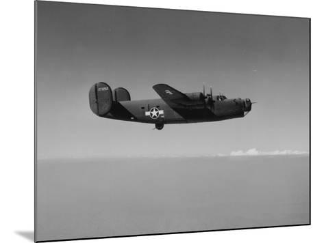Image of a Wwii U.S. Military Aircraft in Flight Taken from the Side and Slightly Below--Mounted Photographic Print