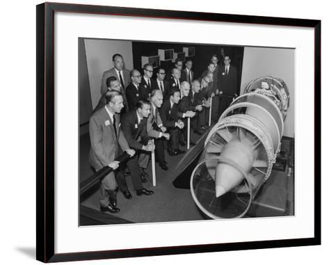 A Group of Men in Suits Looking at a Jet Engine on Display at Museum of Science and Industry--Framed Art Print