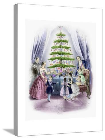 A Family Standing around a Christmas Tree--Stretched Canvas Print