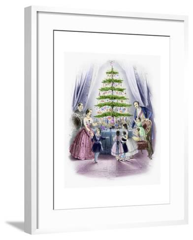 A Family Standing around a Christmas Tree--Framed Art Print
