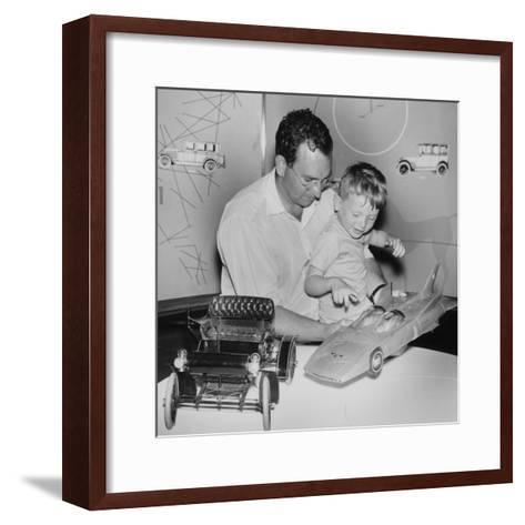 A Father Shows His Son Two Model Cars from General Motors--Framed Art Print
