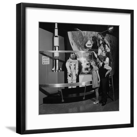 A Group of People Pose on a Ladder in Front of the NASA Apollo Exhibit--Framed Art Print