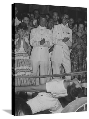 A Crowd Watches a Sailor Do the Limbo--Stretched Canvas Print