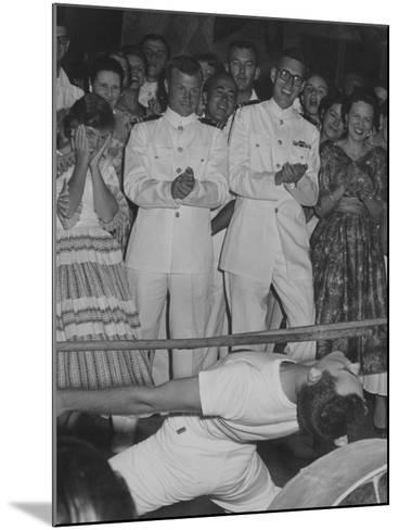 A Crowd Watches a Sailor Do the Limbo--Mounted Photographic Print