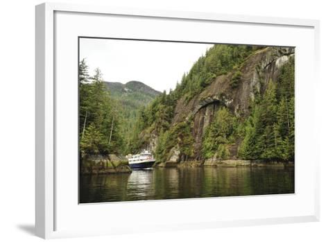 A Small Cruise Ship Passes Through a Narrow, Cliff-Lined Passage in Misty Fjords National Monument-Jonathan Kingston-Framed Art Print