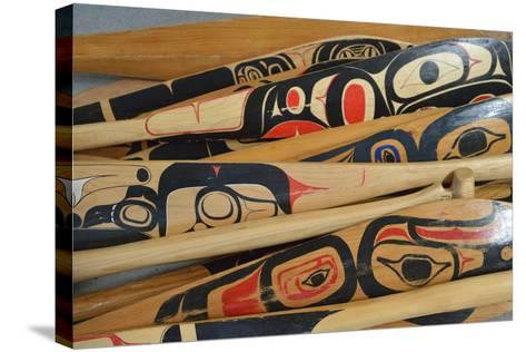 Hand-Painted Haida Canoe Paddles Stacked in the Bottom of a Small Boat-Jonathan Kingston-Stretched Canvas Print