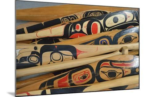 Hand-Painted Haida Canoe Paddles Stacked in the Bottom of a Small Boat-Jonathan Kingston-Mounted Photographic Print