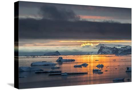 Sunset Off Andersson Island, with Coastal Mountains and Ice Floes-Kent Kobersteen-Stretched Canvas Print