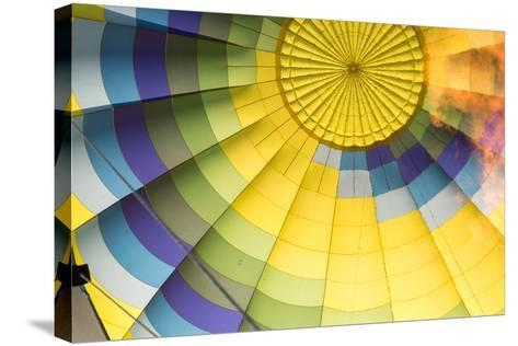 A Flame Is Visible Inside a Colorful Hot Air Balloon-Eric Kruszewski-Stretched Canvas Print