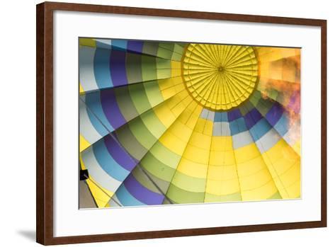 A Flame Is Visible Inside a Colorful Hot Air Balloon-Eric Kruszewski-Framed Art Print