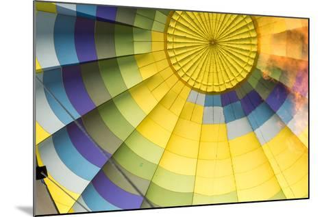 A Flame Is Visible Inside a Colorful Hot Air Balloon-Eric Kruszewski-Mounted Photographic Print