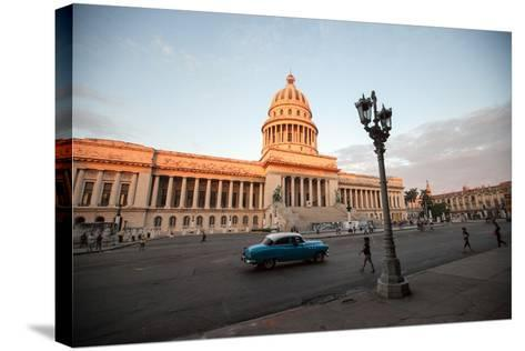 People Walk the Streets and a Classic American Car Drives Past the El Capitolio Building, Havana-Eric Kruszewski-Stretched Canvas Print