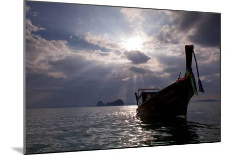 Andaman Sea: A Man Leans Off of a Long Tail Boat in the Andaman Sea under Rays of Light-Ben Horton-Mounted Photographic Print