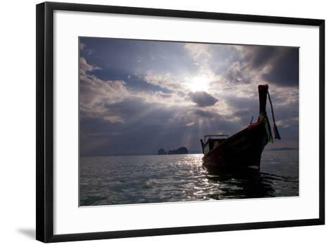 Andaman Sea: A Man Leans Off of a Long Tail Boat in the Andaman Sea under Rays of Light-Ben Horton-Framed Art Print