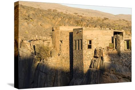 Sunset Touches the Walls of an Ancient Mud Brick Village on a Desert Gorge Mountainside-Jason Edwards-Stretched Canvas Print