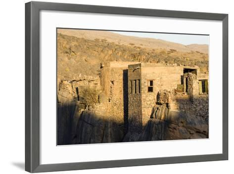 Sunset Touches the Walls of an Ancient Mud Brick Village on a Desert Gorge Mountainside-Jason Edwards-Framed Art Print