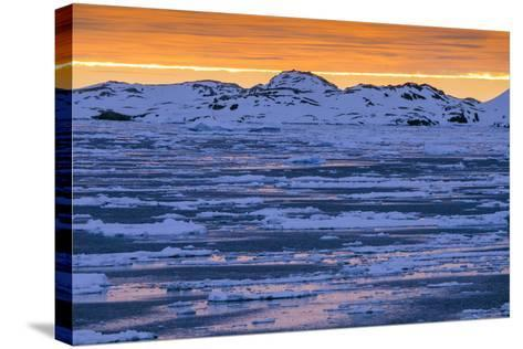 Sunset over Lemaire Channel on the Antarctic Peninsula-Rich Reid-Stretched Canvas Print