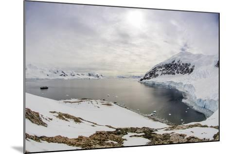 Wide Angle of a Ship and Glacier at Neko Harbor on the Antarctic Peninsula-Rich Reid-Mounted Photographic Print