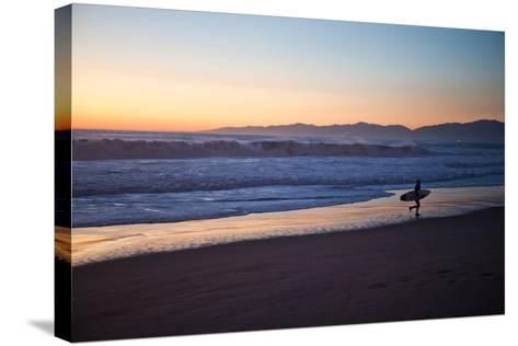 El Porto Beach, Los Angeles, California, USA: A Surfer Exits the Waves at Dusk-Ben Horton-Stretched Canvas Print