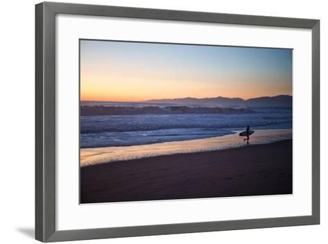 El Porto Beach, Los Angeles, California, USA: A Surfer Exits the Waves at Dusk-Ben Horton-Framed Art Print