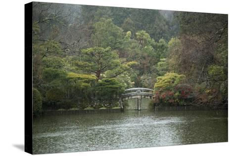 A Traditional Wooden Footbridge in a Rainstorm at Ryoanji Temple-Macduff Everton-Stretched Canvas Print