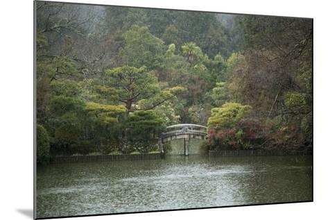 A Traditional Wooden Footbridge in a Rainstorm at Ryoanji Temple-Macduff Everton-Mounted Photographic Print