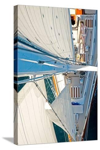 Sea of Cortez, Mexico: A Girl Sunbathes on a Sailboat as Seen from the Tip of the Mast-Ben Horton-Stretched Canvas Print