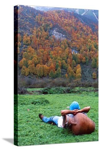 A Hiker Relaxes with His Head on an Urn, and a View of Autumn Colors in the Dohezar Forest-Babak Tafreshi-Stretched Canvas Print