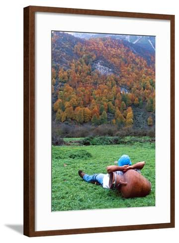 A Hiker Relaxes with His Head on an Urn, and a View of Autumn Colors in the Dohezar Forest-Babak Tafreshi-Framed Art Print