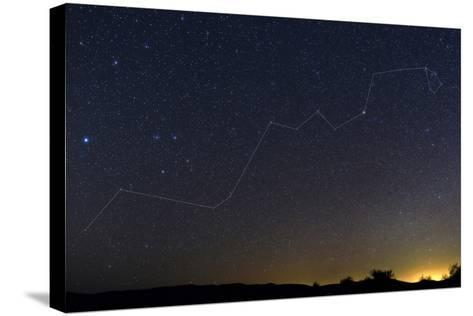 Starry Night over a Desert with the Constellation Hydra and the Light Pollution of a Nearby Town-Babak Tafreshi-Stretched Canvas Print