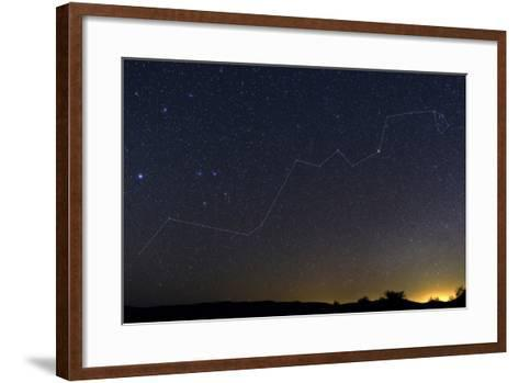 Starry Night over a Desert with the Constellation Hydra and the Light Pollution of a Nearby Town-Babak Tafreshi-Framed Art Print