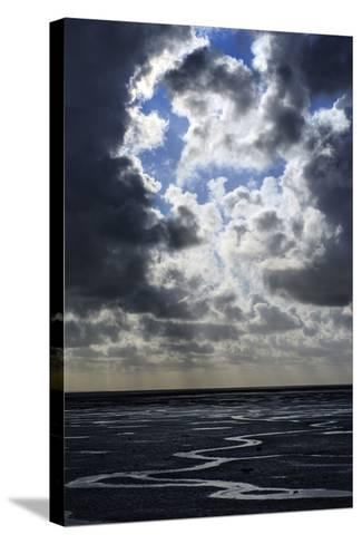 The Ocean Floor at Low Tide in Mont Saint Michel Bay. Heavy Clouds Above and Virga in the Distance-Babak Tafreshi-Stretched Canvas Print