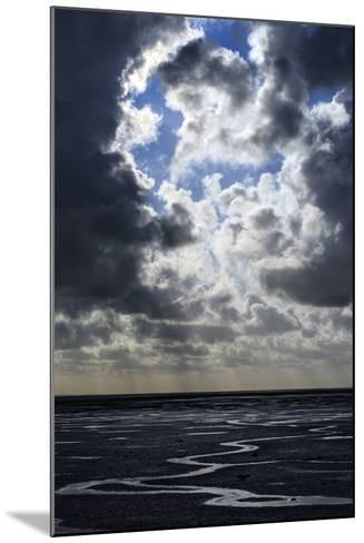 The Ocean Floor at Low Tide in Mont Saint Michel Bay. Heavy Clouds Above and Virga in the Distance-Babak Tafreshi-Mounted Photographic Print