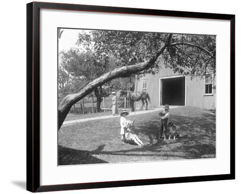 Children of the Mccready Family with a Dog and Puppy Gathered around a Rope Swing Outside a Barn-William Davis Hassler-Framed Art Print