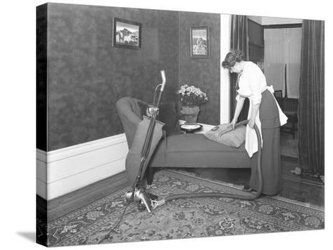 Unidentified Woman Demonstrating the Use of the Apex Vacuum Cleaner's Upholstery Attachment-William Davis Hassler-Stretched Canvas Print
