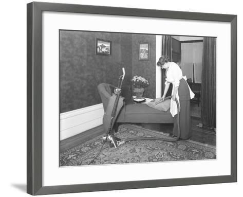 Unidentified Woman Demonstrating the Use of the Apex Vacuum Cleaner's Upholstery Attachment-William Davis Hassler-Framed Art Print