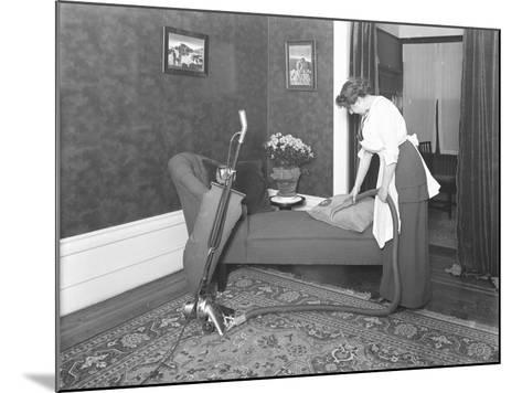 Unidentified Woman Demonstrating the Use of the Apex Vacuum Cleaner's Upholstery Attachment-William Davis Hassler-Mounted Photographic Print