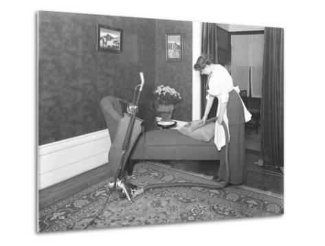 Unidentified Woman Demonstrating the Use of the Apex Vacuum Cleaner's Upholstery Attachment-William Davis Hassler-Metal Print