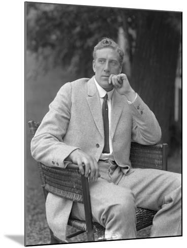 English Boxer William Thomas Wells (Bombardier Billy Wells), Posed Seated in a Tweed Suit, C.1911-William Davis Hassler-Mounted Photographic Print