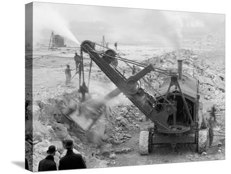 Steam Shovel Removing Rock Loosened by Dynamite, Livingstone Channel, Mich.--Stretched Canvas Print