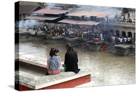 Girls Watch Hindu Cremations at Pashupatinath Temple-Jill Schneider-Stretched Canvas Print